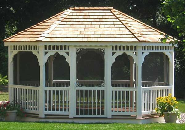 Another classic oval gazebo, this time in vinyl. The spaces are screened in to keep bugs out.