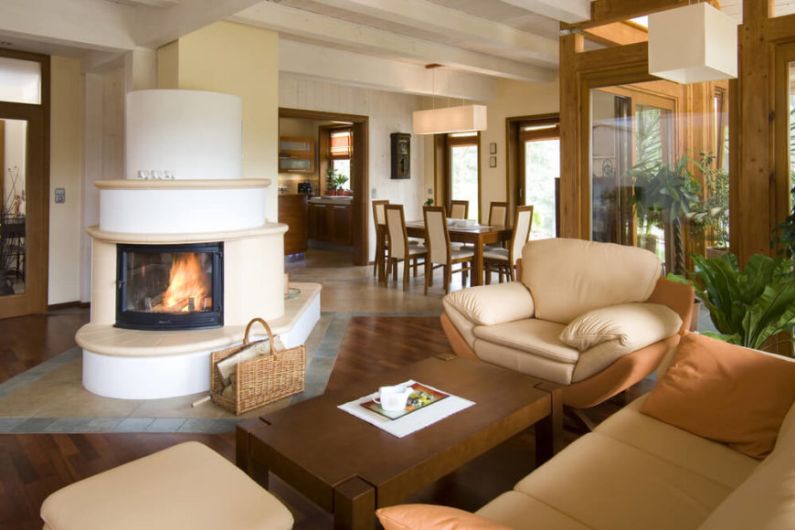 In an open-concept space, a dual-sided fireplace is the perfect addition, so you can get the atmosphere in both a living room area and in the dining room.