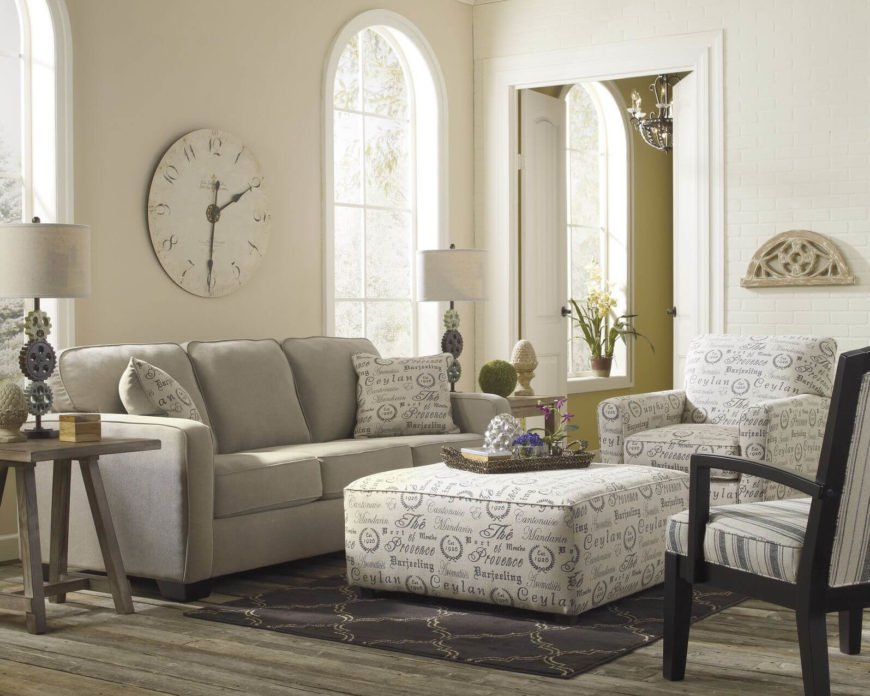 When choosing an ottoman, if you decide to go with fabric, choose a fabric that can be echoed in a chair or in accent pillows to help tie the seating arrangement together.