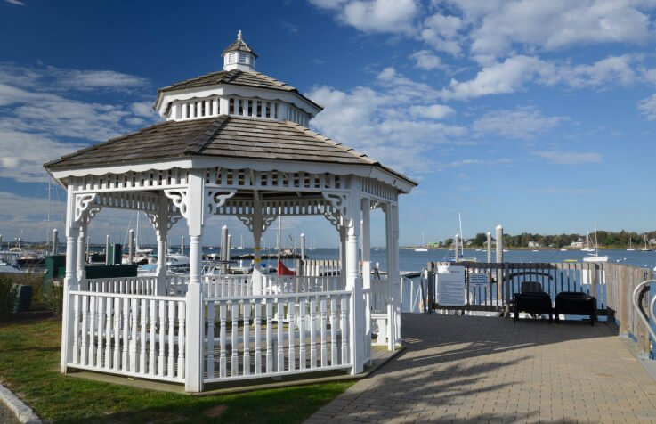 Ornate details on a gazebo are perfect for dressing up a yard. This one has craftsman style details, and adds a bit of elegance to this marina.