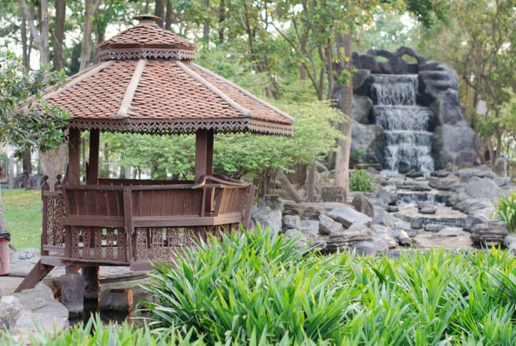 This gazebo has a bit more Asian flair and is situated over a small pool of water adjacent to a stone waterfall.