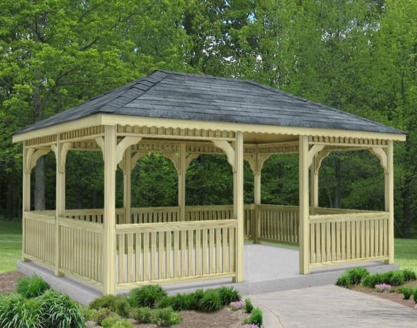 A lovely single-roof pine rectangular gazebo sitting on a concrete pad. This is a classic gazebo style that is large enough to accommodate two separate entertaining areas.