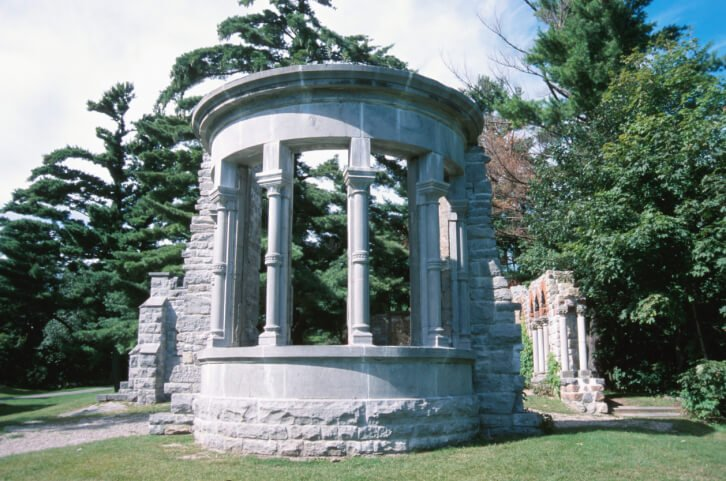 This is an incredible example of a round gazebo made out of sculpted concrete and stone. It has a decidedly majestic and imposing footprint.
