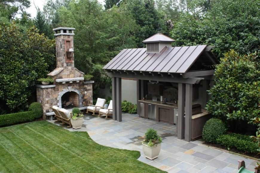 This much larger gazebo acts as a shelter for an entire outdoor kitchen area, complete with granite countertops.