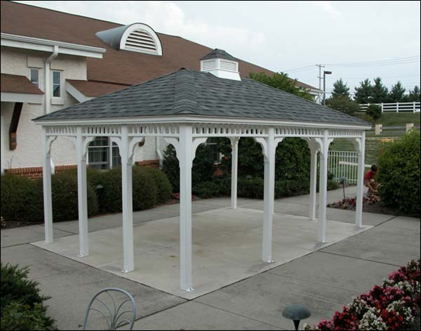 An open pavilion-style gazebo behind the house on a concrete patio. Add some furniture and you'll have a great space to dine outside.