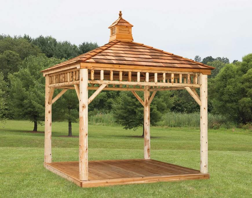 This raw wood log cabin style gazebo has an open design that's perfect for setting a picnic table under.