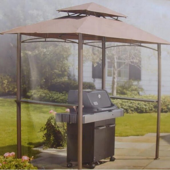 While some grill gazebos are open, this one has glass panels that really protect it from wind, snow, and rain.