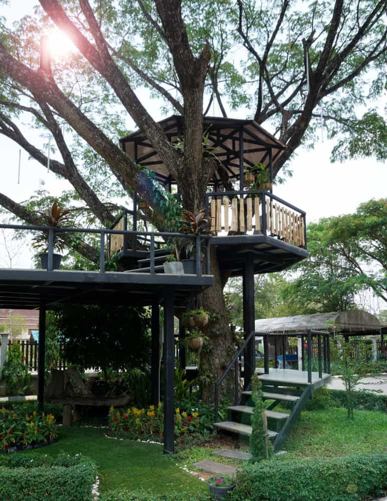 Interesting octagon treehouse in backyard.