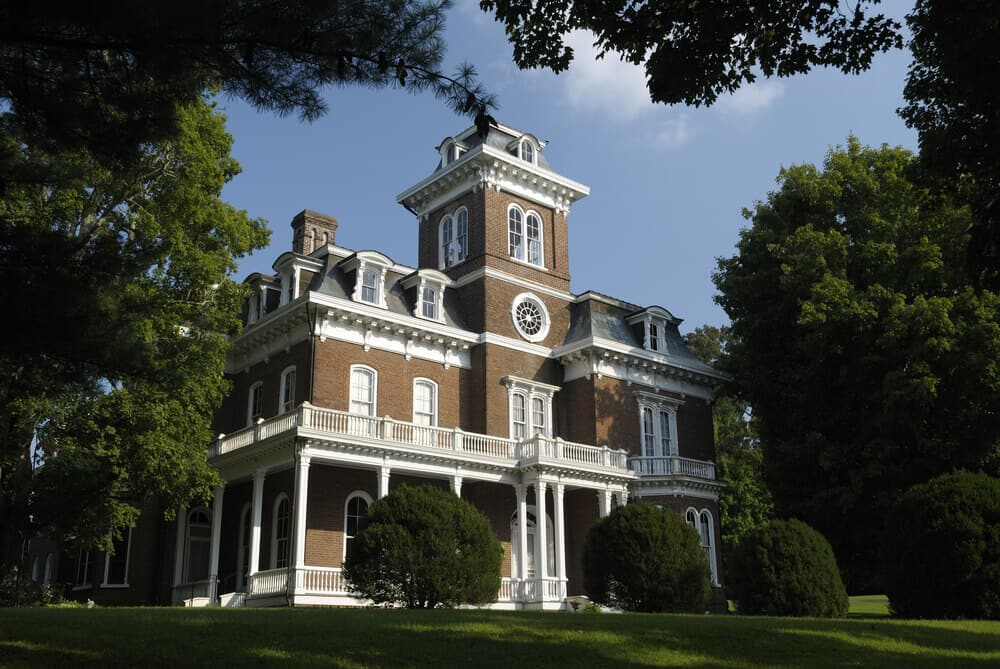 Glenmore mansion in Jefferson City, Tennessee. Large brick home with white trim.