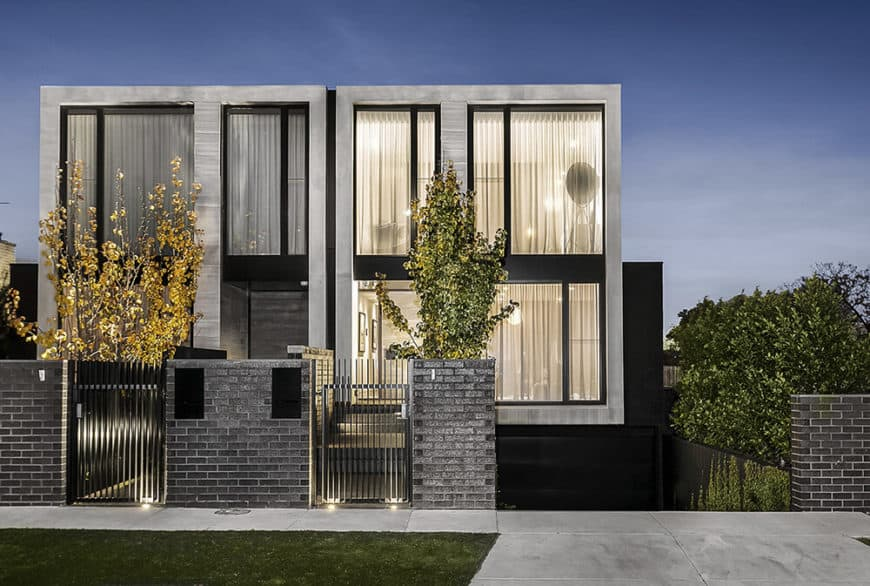 A modern house featuring a stylish gray and black exterior.