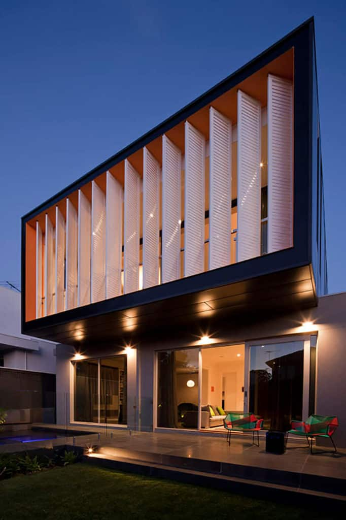This modern house features a stylish exterior design and cozy indoor amenities.