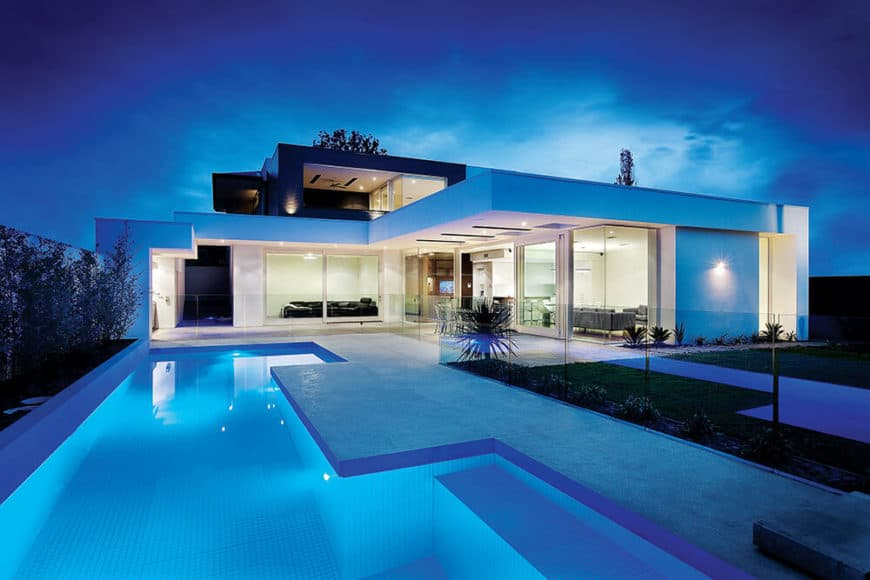 This modern home offers a gorgeous swimming pool outside.