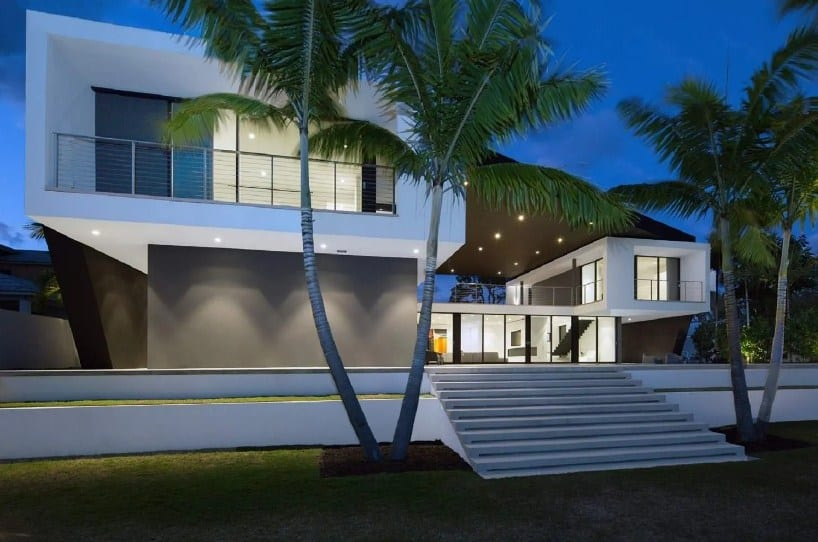 Large modern beach house with a gorgeous exterior and has stylish indoor amenities.