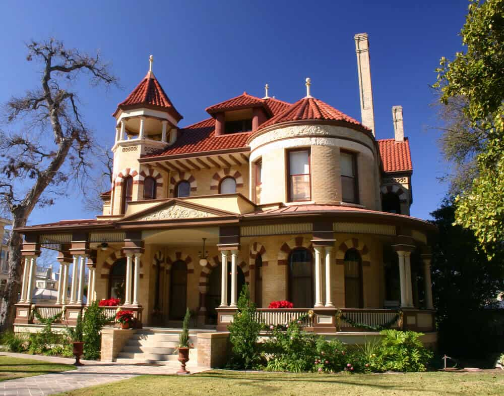 Victorian house with a large front porch and open deck tower located in San Antonio, Texas.