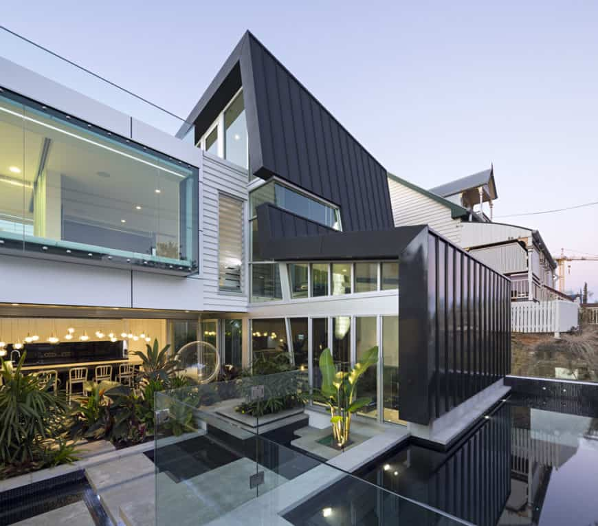 This modern house offers great outdoor amenities with healthy green plants.