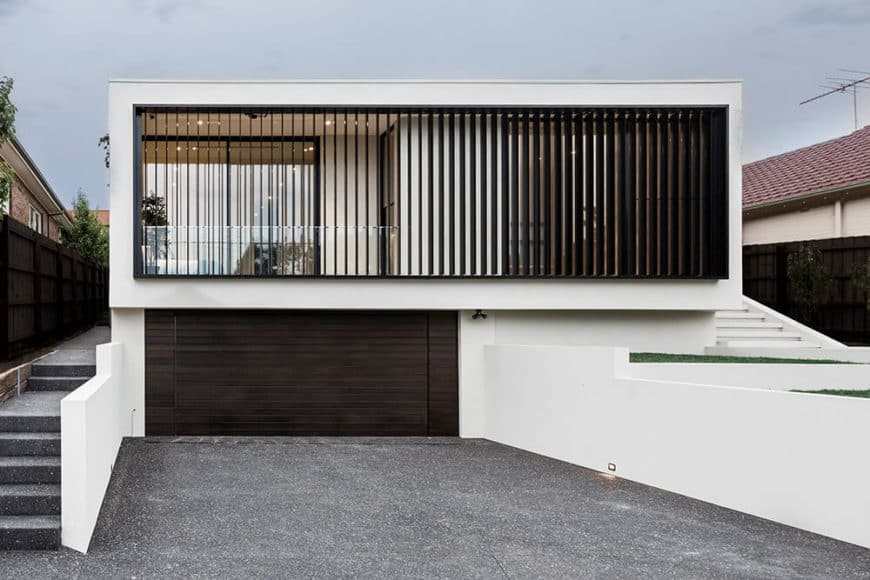A modern custom home with a wide garage and a stylish exterior design.