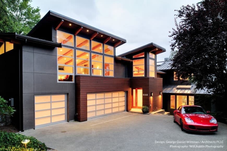 A stylish modern house with a gorgeous interior and a wide driveway and garage.
