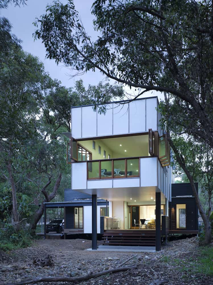 Modern minimalist home featuring a stylish exterior along with a modish interior.
