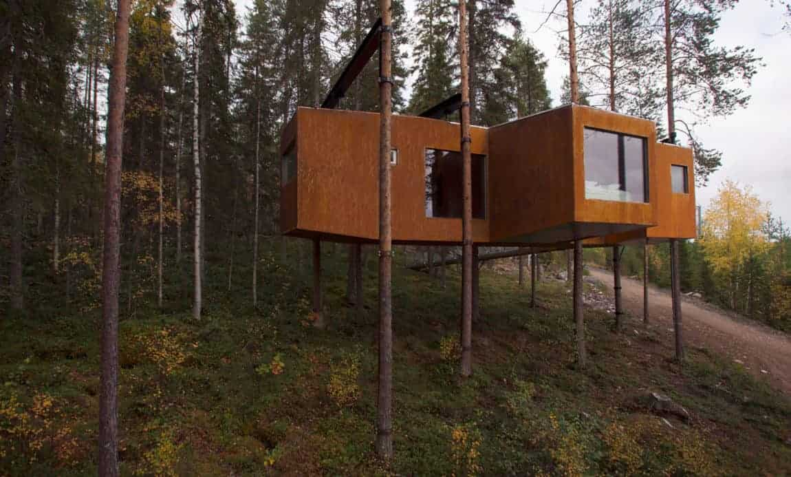 Modern treehouse wih a gorgeous wooden exterior and glass windows.