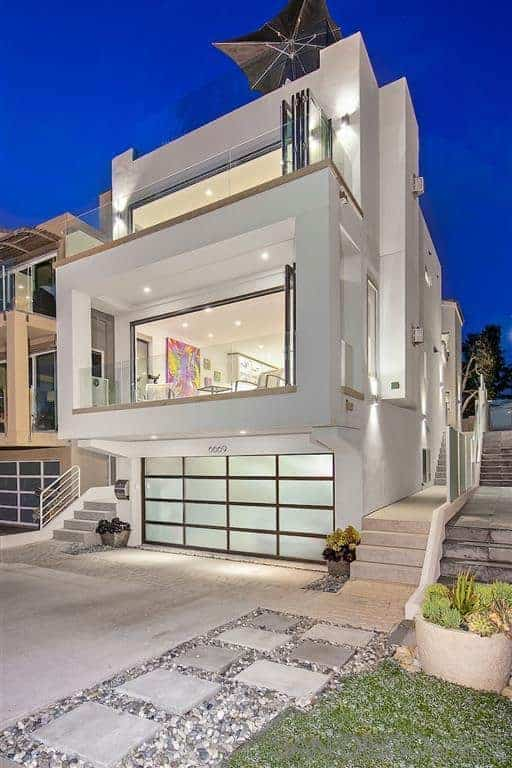 A stunning modern beach house with a pure white exterior and has a gorgeous interior as well.