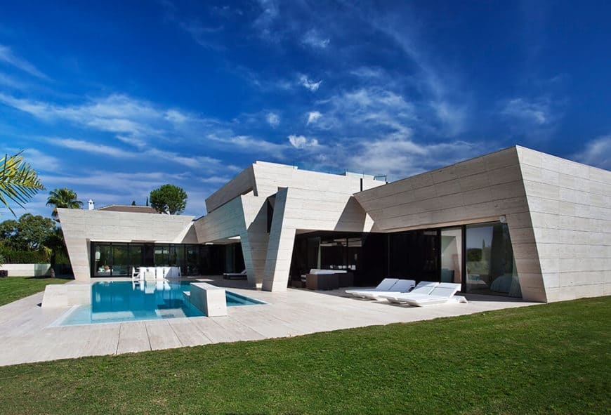 Large modern house featuring a great outdoor area with a swimming pool and an outdoor living.