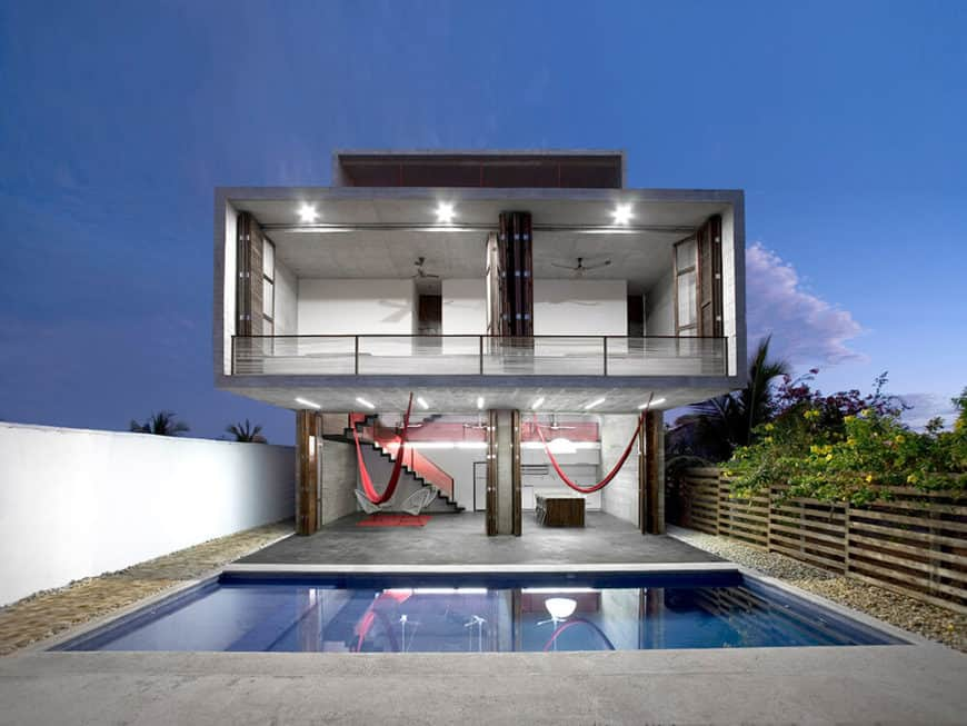 This modern house boasts a small swimming pool outside.
