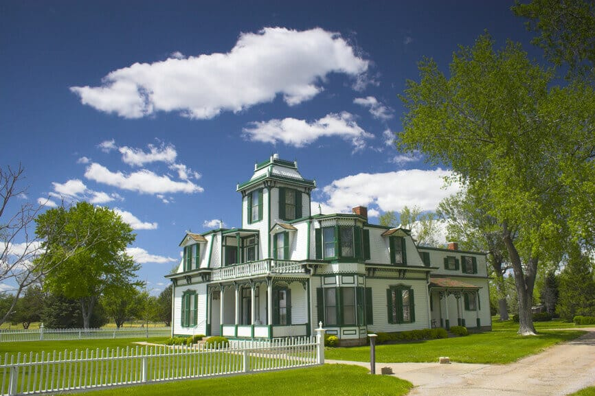 Famous Buffalo Bill's Victorian home in white with green trim located in Nebraska.