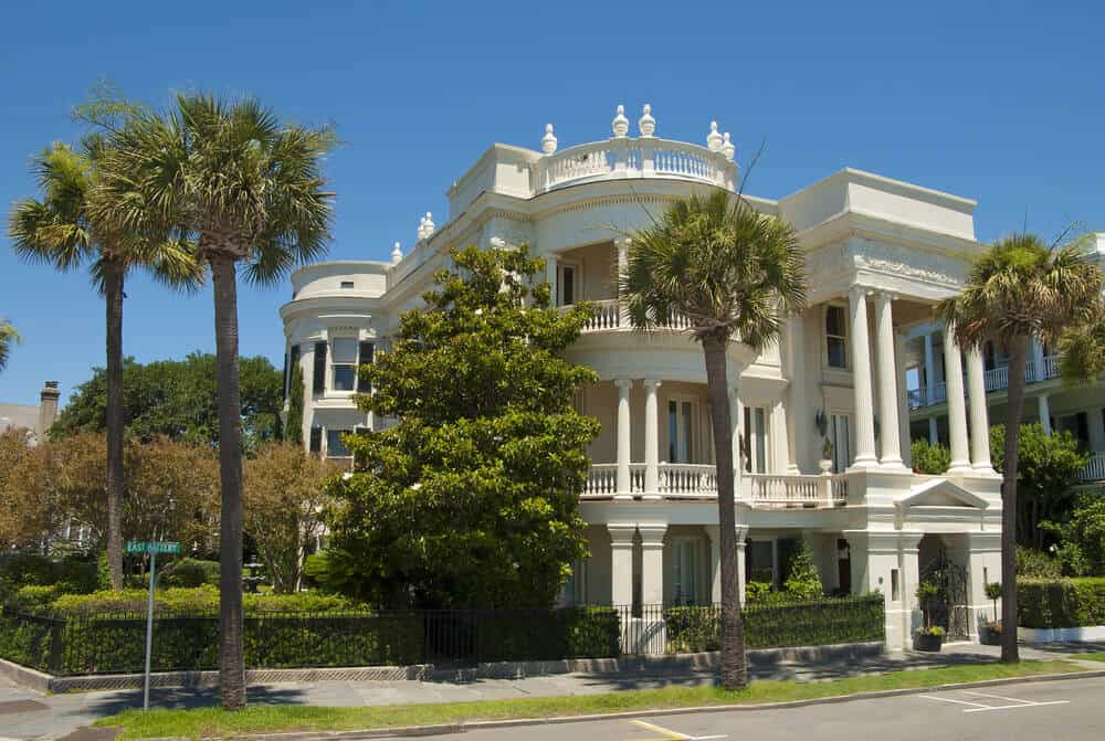 White Victorian mansion with extensive use of pillars located in Charleston, South Carolina.