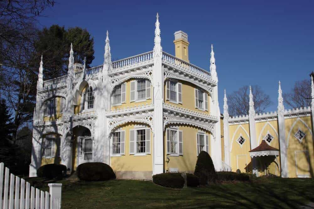 Yellow and white Victorian cake house.