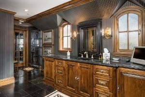 masculine primary bathroom with dark grey walls and black floor.