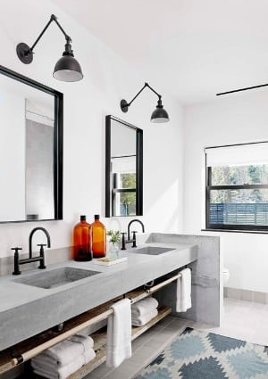 White primary bathroom with wall-mounted lights.