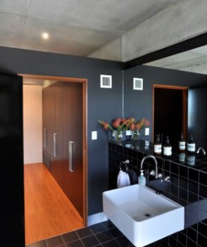Master bathroom with dark grey walls.