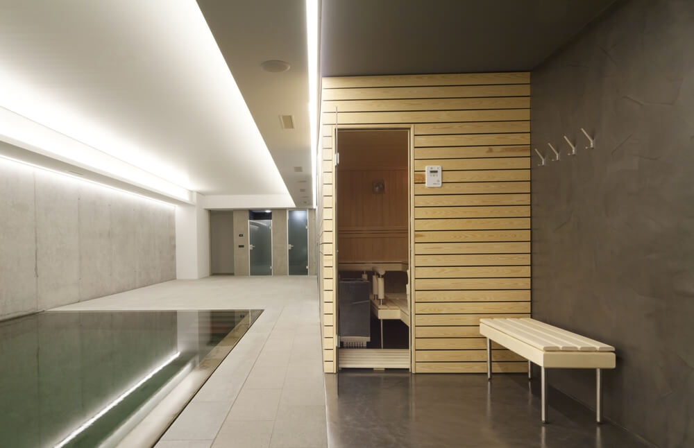 Exterior of a small sauna in private residence in the indoor pool area.