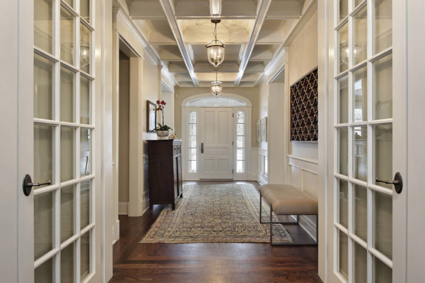 Moderately sized one-story foyer in white designed in a hallway layout leading to various rooms of the home.