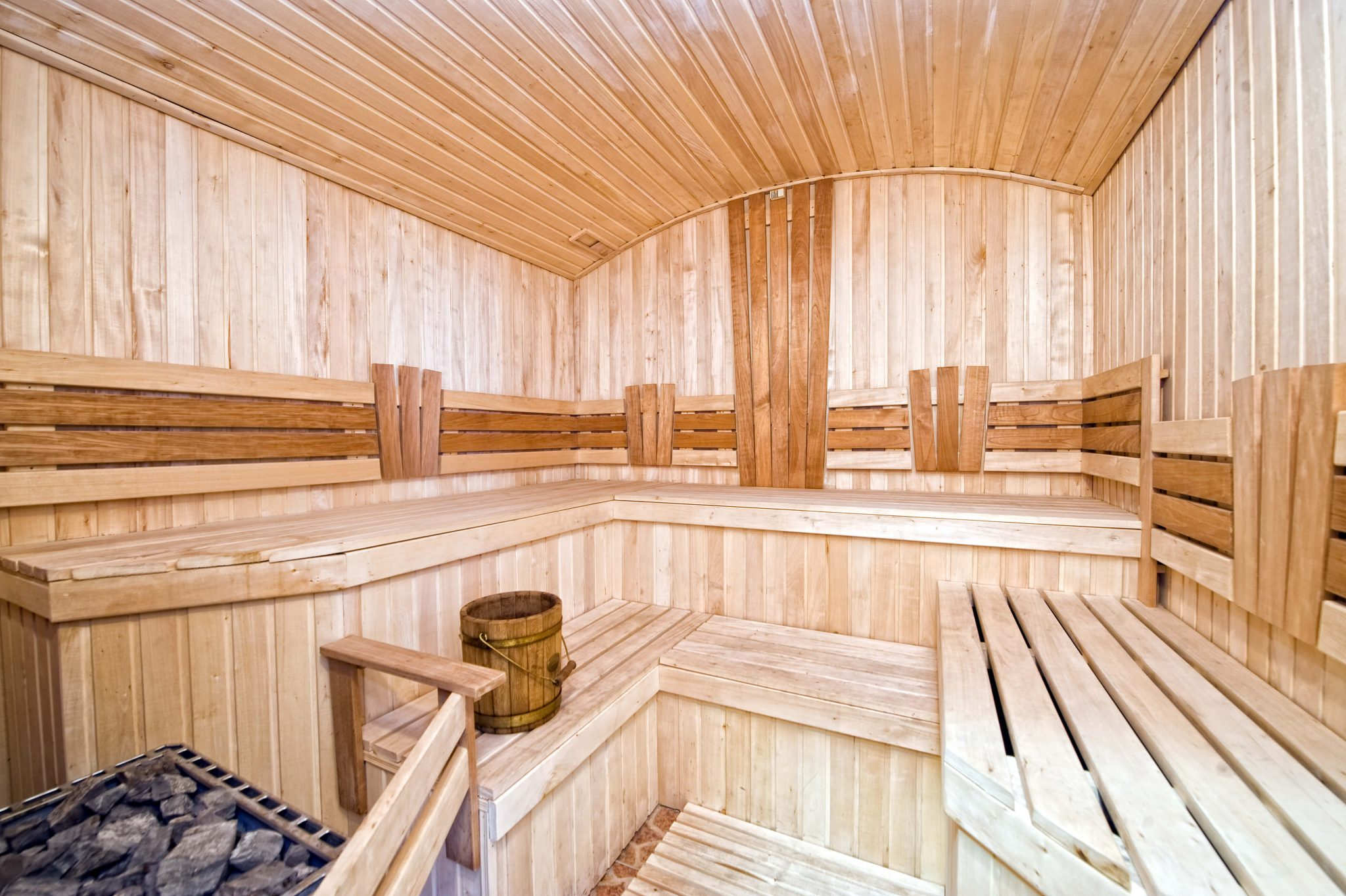 Staggered tiered sauna interior with arched roof