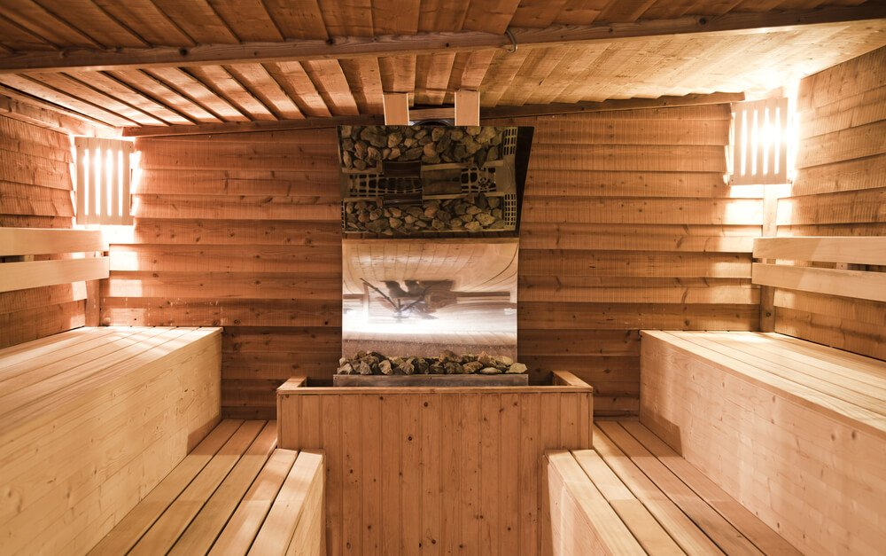 Two-tiered sauna with benches facing one another which is not a typical design but is nice for facing one another when chatting. This sauna layout also provides more bench space for lying down.