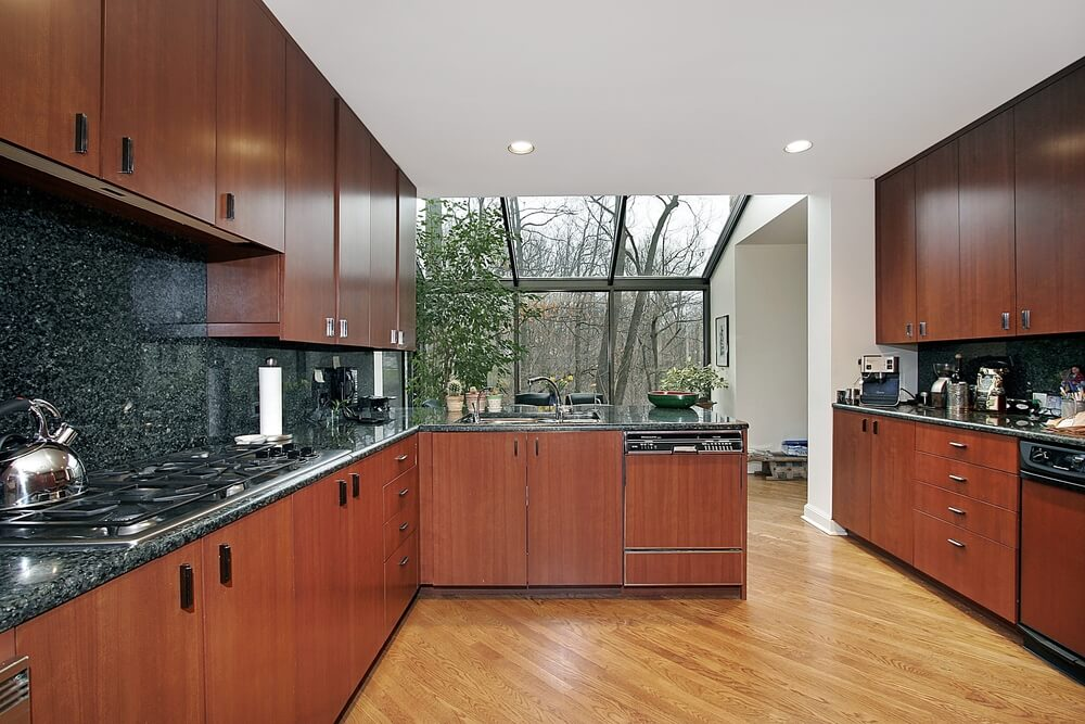 Here we have another set of warmly colored, minimalist wood cabinets set over a lighter, natural toned hardwood floor.