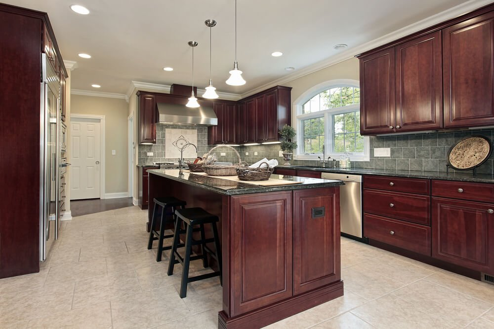 Another example of cherry wood really standing out in a lighter hued kitchen.