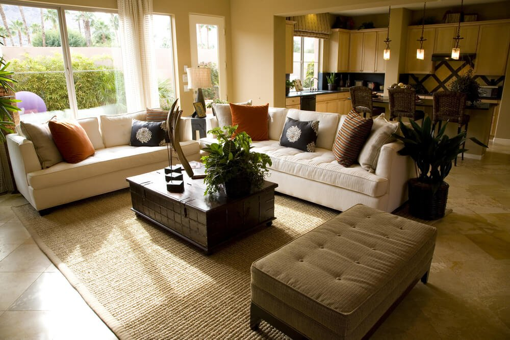 This living room design demonstrates an interesting tip and that's the separate ottoman which can serve as a feet rest or second coffee table.