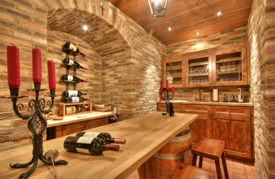 Interior of the wine cellar with tasting table and counter. Wine cellar can store up to 45 cases of wine.