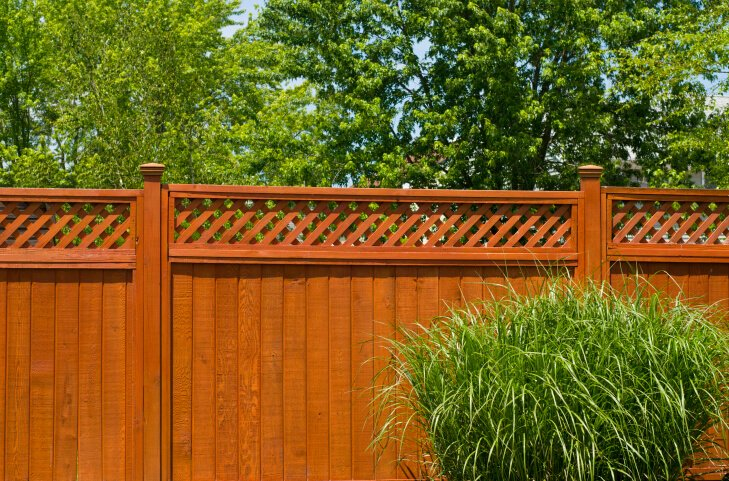 Formal look privacy fence featuring upper lattice work design.