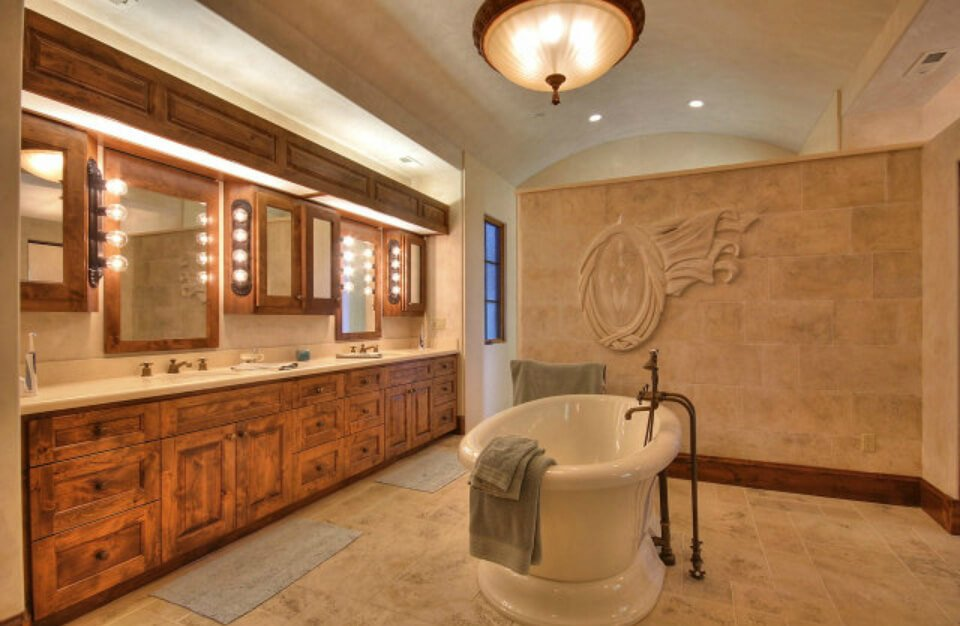 Interesting primary bath design with a large free-standing tub dead-center of the room.