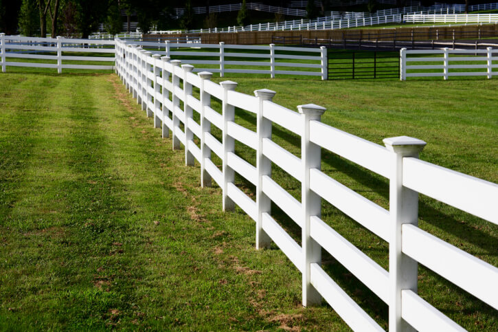 Here's another four-slat white fence, with large vertical posts capped with pyramid shape.