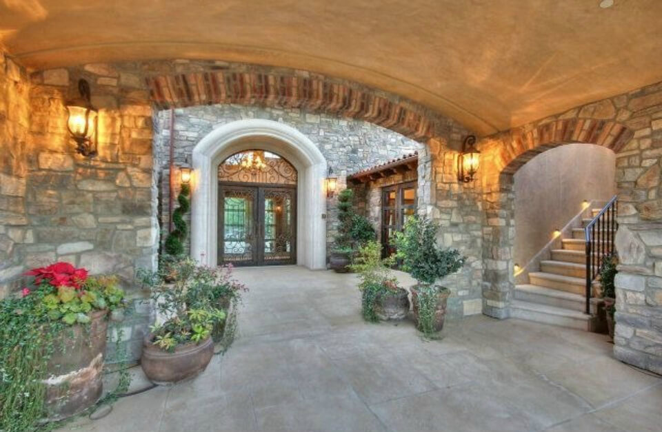 Outer walkways to the grounds. Looks very Italian with stone work creating nooks and crannies. This could be courtyard found in many Italian villages.