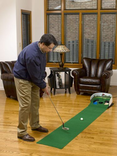 Here's a similar rolled-surface putting green, meant for portability and placement in any space with room and a flat surface. This example features two small hazards flanking the hole.