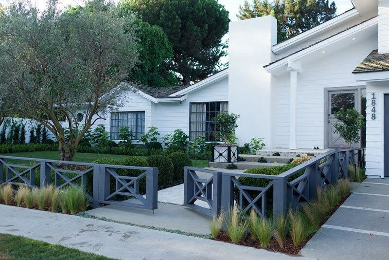 Unique spin on the waist-height fence, featuring striking cross-hair box design in dark grey and double-swing entry.