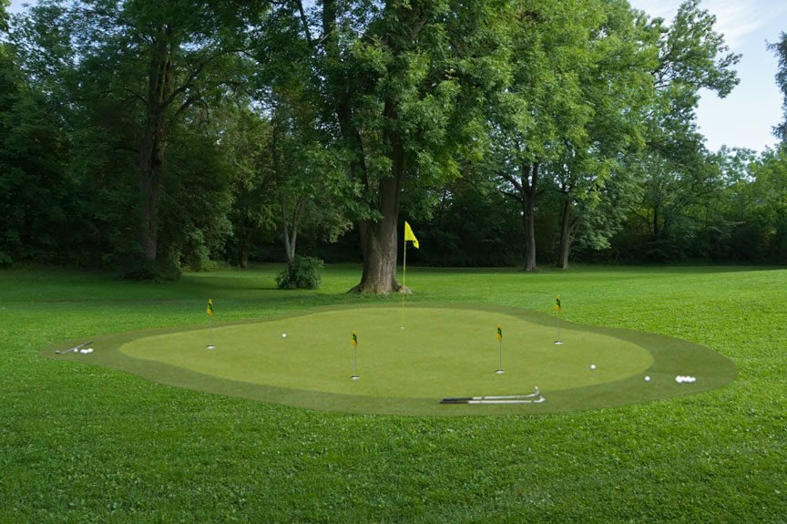 Here's a sprawling, lush lawn with this professional looking green resting at the center. Subtly rolling surface includes multiple holes and is shaded by nearby hardwood trees.
