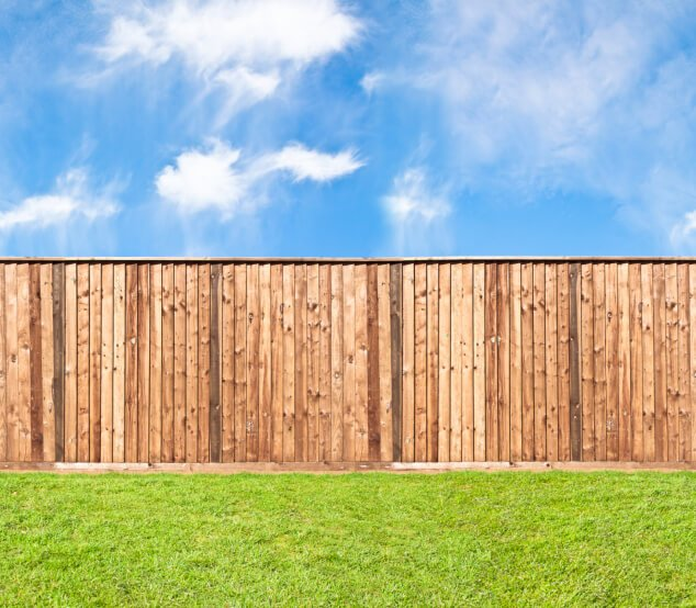This privacy fence in natural unstained wood features top horizontal layer.