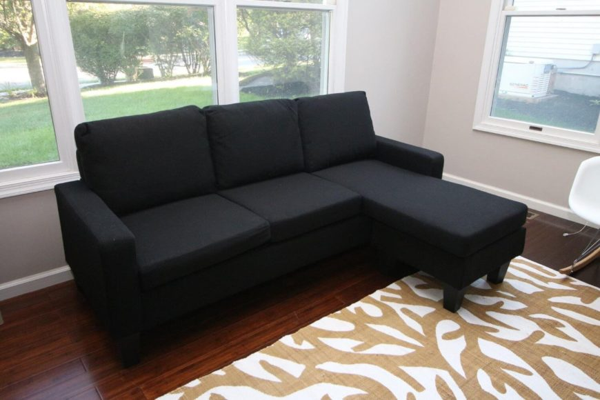 A rich black cloth sectional with a sleek modern silhouette. Perfect for a modestly sized living room. The chaise can be placed on the left or right to accommodate most rooms.