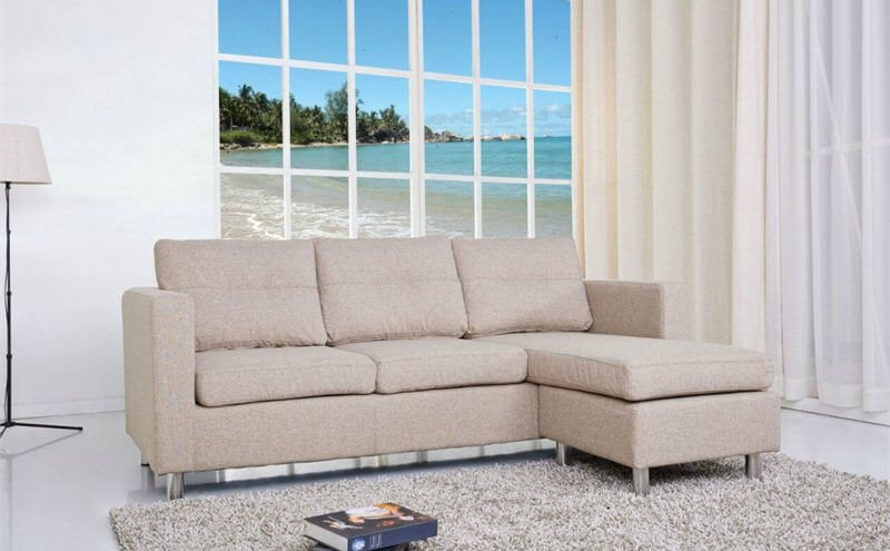 This cozy sectional features durable fabric with detailed stitching, chrome legs, comfortable cushioned back cushions. This three-piece sectional also includes an ottoman. Shown in camel.
